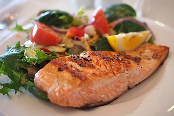A typical meal might include grilled salmon with vegetables.