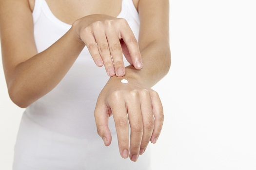 You could add a few drops of pure grapefruit oil to your hand cream.